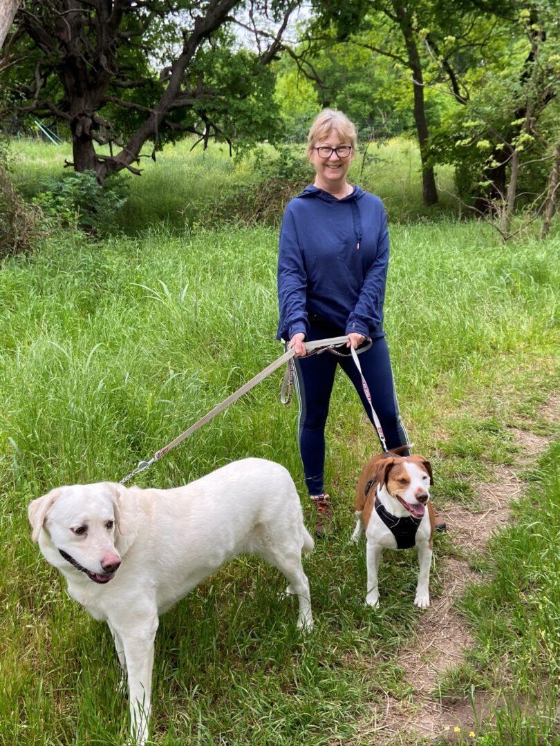 Vannetta walking her two dogs